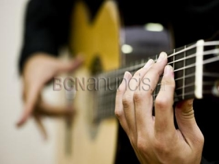 Classes de guitarra per a nens i adults 60e/mes