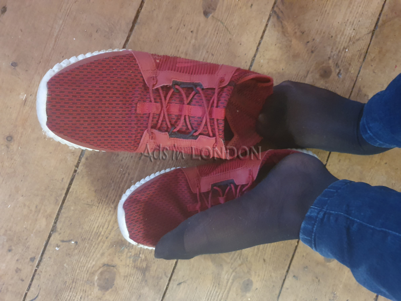 Worn red trainers