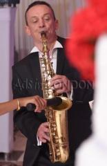 London Office Party Sax Player